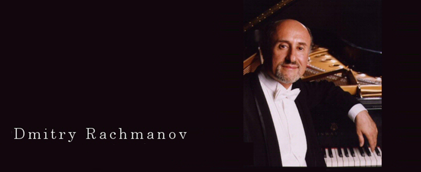 Dmitry Rachmanov leaning on the grand piano